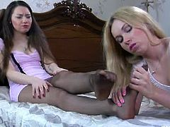 Frisky lesbians Becca A and Crystal shows each other their foot fetish secrets. Using their sexy feet while wearing pantyhose. They mash and stroke their fresh flower to cum.