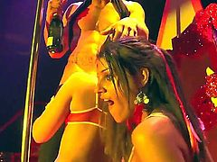 Two hot sluts feeling horny and wishing for a good fuck wake up a sleeping man-whore, having a lot of fun fucking and sucking each other in a threesome action in a noisy club.