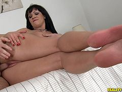 Long-haired Nia Black comes to a massage parlour. The masseur oils and rubs Nia's body and then fingers the bitch's cunt and sees that she doesn't mind to have sex with him. So, he takes his chance.