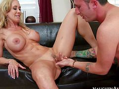 Hot bodied mature lady Brandi Love with massive firm tits strips out of her tempting black lingerie in front of handsome young guy and makes his hard dick disappear in her mouth. Then she takes his love torpedo up her pussy. Shes his sex teacher!
