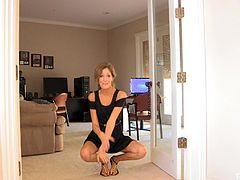Click to watch this blonde babe, with natural boobs wearing a cute dress, while she moves in an erotic way around her glamorous house.