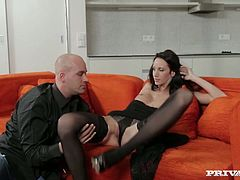 Seductive girl with incredibly hot and sexy body shape is having passionate foreplay on a couch. Handsome dude goes down on her tickling her fancy with tongue.