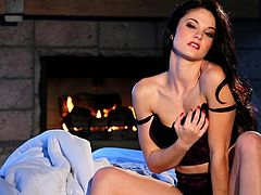 Adorable brunette girl in a sexy lingerie poses for a camera. Then she undresses seductively and plays with her pussy.