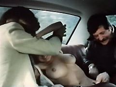 That bitchy black haired lassie lied on the back seat of car and got stripped. Two hungry studs set to lick her pussy and fuck her dirt mouth hard. Look at that dirty 3 some in The Classic Porn sex video!