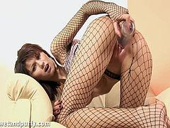 Share this with your friends! A brunette babe, with a nice ass wearing fishnets, masturbates fervently in a sexy solo model video.