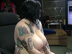 Horny tattooed slut with massive jugs rides big cock face to face. Her tits are saggy but they bounce like crazy balls while she hops on cock.