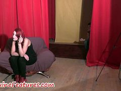 A redhead babe talks to another babe in the backstage of her casting. She smokes a cigarette and talks to that girl before she takes her pants off and prepares.