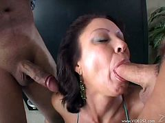 Curvaceous brunette goddess gets her hairy cunt poked doggystyle and rides cock on top while giving a head to other man. She also gets screwed mish until buddy fills her twat with jizz.
