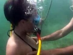 Hot girl and a guy dive and have sex on the sea bed. The girl gives a blowjob and then gets fucked from behind. It seems that this couple have great underwater sex experience.