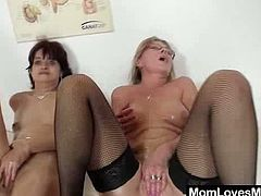 Horny blonde milf, wearing a nurse uniform, is having fun with a short-haired brunette. The lesbians oil their cunts and tits, then demonstrate their fingering skills.