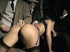 Big buttoned brunette hottie pleased two thirsting guys with hard deep throat in retro auto. Look at that dirty 3 some in The Classic Porn sex clip!