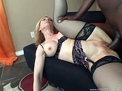 A sexy, blonde pornstar with big, fake tits and a hot body enjoys sucking a massive black cock. Hear her moan with pleasure right now!