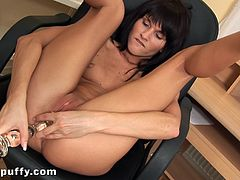 A sexy brunette girl in pink thong shows her pussy lying on an office chair. Dolly rubs her clit and toys the pussy with the dildo. She also licks this dildo to taste her juices.