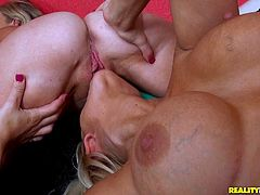 A very sexy lesbian with long blonde hair, big fake tits and a great body enjoys getting her wet pussy and asshole licked.