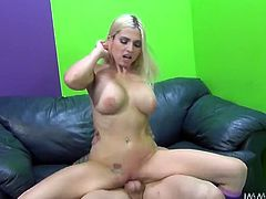 This spoiled blonde with big round tits knows how to please her man. She sucks her lover's dick passionately to get it hard and ready. Then she rides his throbbing dick reverse cowgirl style.