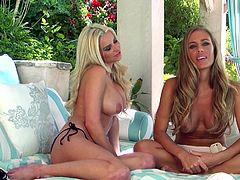 Dude, here are Nicole Aniston and Spencer Scott to blows your mind forever! Two marvelous ladies sit on the sofa and take off their bras exposing big juicy boobs.