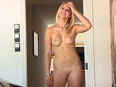 Blonde hottie Lacie is having a good time in the living room. She strips and shows her body for the camera, then stretches her pussy out and plays with her boobs.