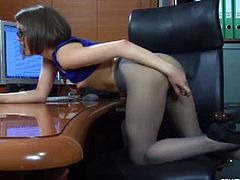 Sexy office secretary Mishelle A wearing sexy sheer pantyhose suddenly reveals her new dildo and plays with it. She was leaning on her table toying herself to orgasm