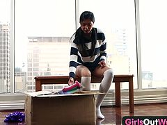 Check out this cute brunette teen babe having some fun by the window of a big building. SHe shows her tight pussy and tests different toys to make herself cum.