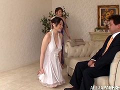 Two well-endowed Japanese milfs are having fun with a guy in the living room. They show their massive natural jugs to the stud and let him fuck their twats in the missionary position.