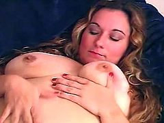 Take a nice look at this chubby blonde, with big knockers and a shaved pussy, while she touches herself ardently in a solo model video.