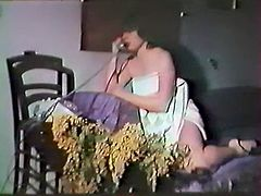Curly and black haired whore with big droopy titties pleases her hungry vagina with unknown item looking as a dildo. Take a look at that awesome solo in The Classic Porn sex clip!