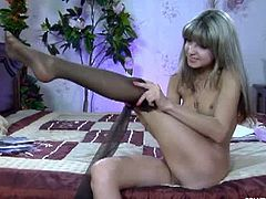 Gina Gerson is a lovely blonde who slowly puts on a black pair of pantyhose. She doesn't have panties on. She is dressed just with that sheer pair of pantyhose.