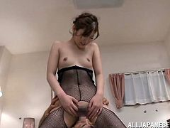 Kinky Japanese chick, wearing fishnet bodystocking, is having fun with two men indoors. The dudes lick the woman's shaved pussy, then fuck it in the missionary position by turns.