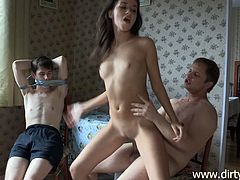Cheating boyfriend gets tied up and is forced to watch his girl getting drilled by a big hard cock that ends up shooting a big load on her tits.