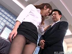 Horny Japanese office girl Ayu Sakurai is playing dirty games with two dudes indoors. She sucks the guys' schlongs and allows them to play with her twat and fuck it by turns.