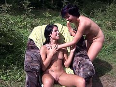 Horny lesbian Lucy Belle and her naughty friend get hot in the woods as they lick their pussies and drill each other with a huge dildo.