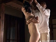Submissive Sayoko gets tied up by an old dude. This slim Japanese girl gets tortured and humiliated. The man pours hot wax on Sayoko;s nude body and also whips her.