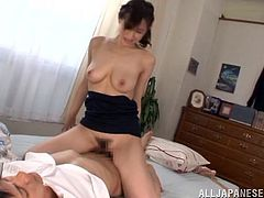 Be part of this clip where an Asian brunette, with big love pillows and a hairy pussy, goes hardcore with a dude and moans like a slut.