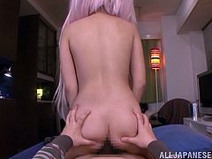 Long-haired Japanese chick shows her butt to a guy and lets him drive his wang in her pussy. They bang in the cowgirl position and the skank can't help but moan sweetly with pleasure.