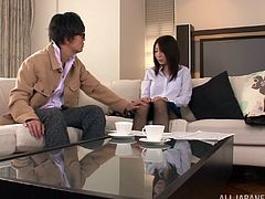 Slim Japanese hottie, wearing a blouse and a skirt, is playing dirty games with two dudes indoors. One of the men asks the chick to strip and demonstrate her snatch. The girl agrees and flashes her cunt.