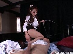 Well-endowed Japanese milf, wearing a nurse uniform, is trying hard to please a man. She gives a hot handjob to the dude and fucks him in the cowgirl position.