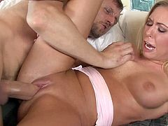 The amazingly sexy blonde Brynn Tyler rides a big hard cock wearing her pajamas and ends up getting her precious mouth filled with cum.