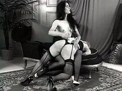 This scorching mistress enjoys spanking her slave's fine ass. Every stroke sends this chick into a raging storm of desire.