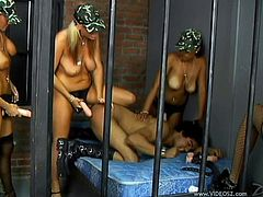 Take a look at this hot scene where these horny ladies strapon fuck this guy in a cell as you can hear her him moan as they take turns.