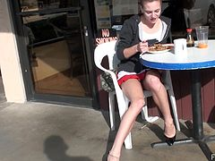 Take a look at Kasey's pink shaved pussy in this public solo scene where this beautiful teen brunette has a coffee in a diner.