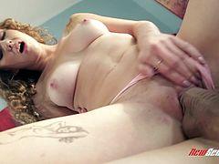 Have a good time watching this redhead babe, with natural boobs wearing a thong, while she gets fucked in the missionary position.