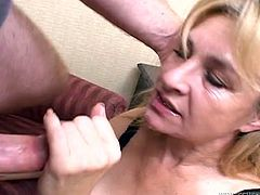 This mature skank has the mouth every guy want to fuck. Horny dude grabs her by her head and pulls her towards his rock hard erection so she can blow him. She sucks his dick greedily. Then he fucks her tight pussy in missionary position.