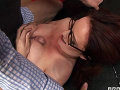 A sizzling hot cougar with long red hair, big natural tits and an awesome body enjoys a fantastic missionary style fuck.