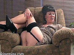 Get a load of this brunette's great ass and shaved pussy in this solo scene where she wears stockings while having a smoke.