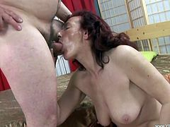 The redhead mature Hana enjoys getting her hairy wet pussy drilled and ends up getting a big load of cum on her huge natural tits.
