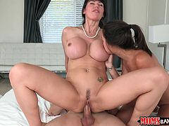 Get a load of this hardcore video where this horny milf and her sexy daughter share her son-in-law's big cock in a threesome.