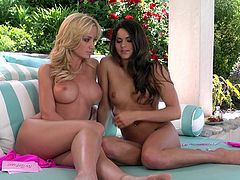 Check this blonde chick and a brunette doll, with long hair wearing hot bikinis, while they act naughty outdoors and talk dirty to the camera.