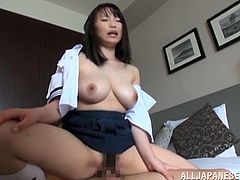 Horny Japanese tart Akane Yoshinag, wearing a college uniform, shows her huge natural tits to a guy and lets him knead them. After that they fuck in the cowgirl and the missionary positions.
