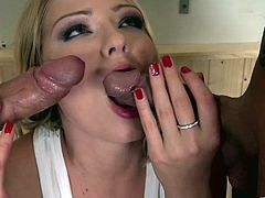 Check out this hardcore scene where the sexy blonde Lucy Heart ends up with her mouth filled by semen after a threesome with two guys.
