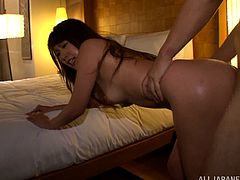 Adorable Asian bitch starts kissing with dude and gives his terrific head. Thereafter she gets her snatch hammered doggystyle and jumps on dick in a cowgirl pose.